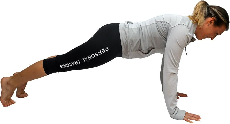 Liegestütz Position von Melanie Heilemann im Sport Outfit
